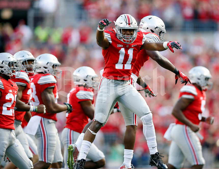 Ohio State Buckeyes safety Vonn Bell (11) celebrates his interception with Ohio State Buckeyes cornerback Eli Apple (13) against Hawaii Warriors in the second quarter of their game at Ohio Stadium on September 12, 2015.  (Dispatch photo by Kyle Robertson)