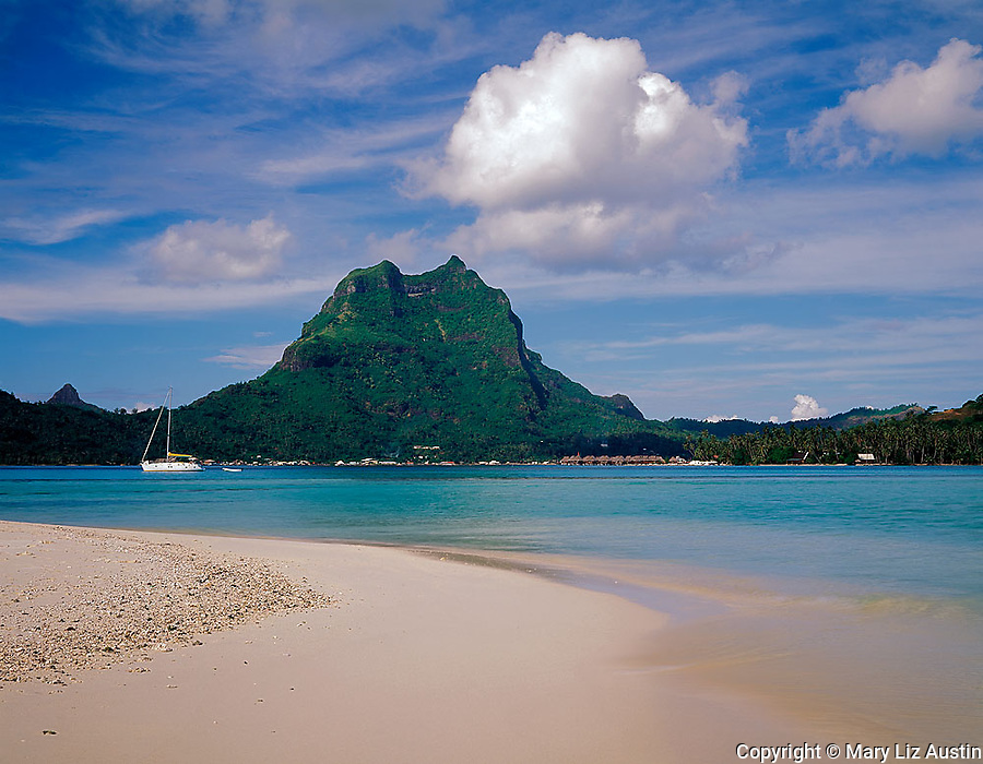 Bora Bora, French Polynesia   <br /> View of Bora Bora across the tropocal waters of Bora Bora lagoon from an atol beach