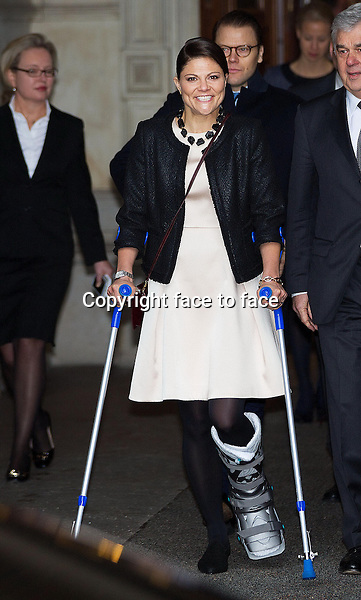 28-01-2014 Hamburg Princess Victoria on crutches with a foot injury which she suffered during her ski holiday and Prince Daniel leaving the Rathaus for a 2 day visit to Germany in Hamburg.<br />
