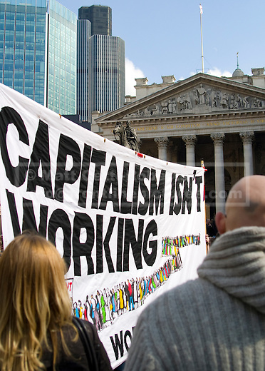 Protesters with a banner outside the Bank of England.