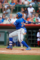 St. Lucie Mets third baseman Jhoan Urena (24) follows through on a swing during a game against the Florida Fire Frogs on July 23, 2017 at Osceola County Stadium in Kissimmee, Florida.  St. Lucie defeated Florida 3-2.  (Mike Janes/Four Seam Images)