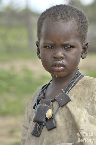 A boy in Dondona, an Arab village in South Darfur that has received families displaced by fighting between Arab communities.