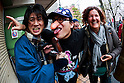 Visitors pose for a photograph during the Kanamara Festival in Kawasaki on April 3, 2016, Kanagawa, Japan. The Kanamara Matsuri or Festival of the Steel Phallus is held on the first Sunday of April at the Kanayama shrine. The shrine celebrates a legend of a steel penis and was frequented by prostitutes who wished to pray for protection from sexually transmitted diseases. Visitors now wish for easy delivery, marriage and matrimonial harmony. Because of the large steel phallus the unusual festival has become a tourist attraction attracting many overseas visitors and is used to raise money for HIV charities. Phallus shaped candy, carved vegetables, decorations, and a big parade are all part of the festival. (Photo by Rodrigo Reyes Marin/AFLO)