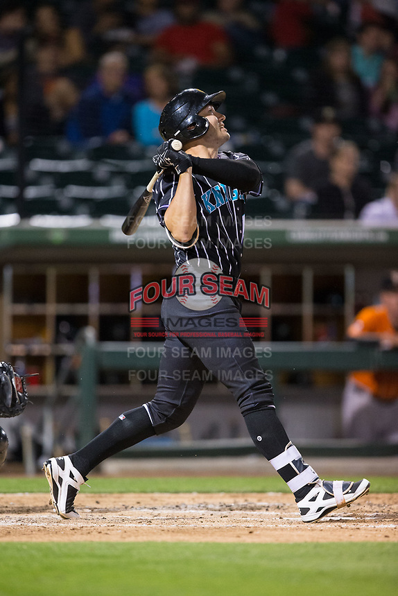 Nicky Delmonico (13) of the Charlotte Knights follows through on his swing against the Norfolk Tides at BB&T BallPark on May 2, 2017 in Charlotte, North Carolina.  The Knights defeated the Tides 8-3.  (Brian Westerholt/Four Seam Images)