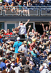 Fans try to catch a foul ball at a spring training game in Peoria, Ariz., on Wednesday, March 16, 2016. <br /> Photo by Cathleen Allison