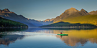Kayacking on Bowman lake in the fall.  Bowman Lake is located in the North Fork area of Glacier National Park approximately 32.5 miles from the west entrance, and 30 miles from the Canadian border. The drive to Bowman Lake is a very slow, dusty, and bumpy ride on dirt roads, and passes through the tiny community of Polebridge and sections of the park that notably burned in 1988.