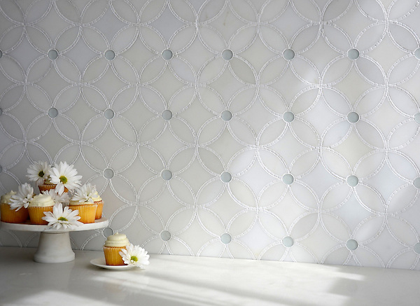 Esferitas,  a stone and glass and waterjet mosaic, shown in honed Paperwhite, tumbled Thassos, and Tropical White glass. Designed by Paul Schatz for New Ravenna.<br />