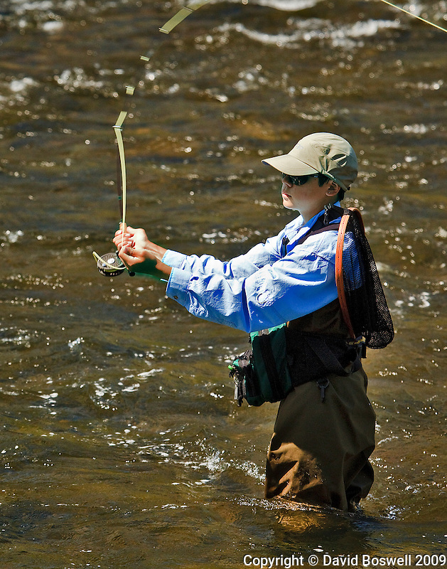 My son Ethan fly fishing on the Firehole River near the confluence of the Firehole and the Gibbon to form the Madison River, in Yellowstone National Park.