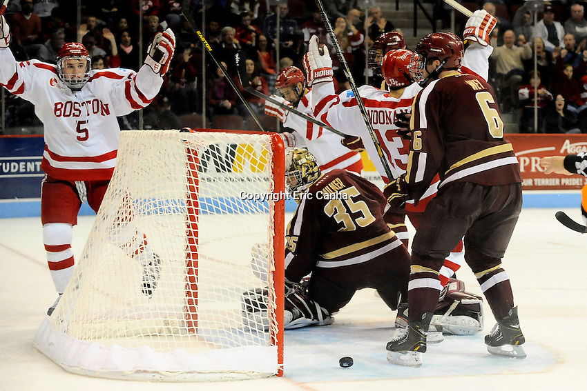 Boston University Terriers defenseman Matt Grzelcyk (5) celebrates his first career BU goal during the third period of the  Boston University vs Boston College NCAA hockey game played at the Agganis Arena, in Boston Massachusetts.  Eric Canha/CSM/