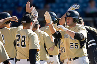 Weldon Woodall #25 of the Wake Forest Demon Deacons high fives his teammates after scoring a run versus the Duke Blue Devils at Jack Coombs Field March 29, 2009 in Durham, North Carolina. (Photo by Brian Westerholt / Four Seam Images)