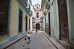 HAVANA, CUBA -- MARCH 24, 2015:   Children wearing school uniforms walk in the Old Havana neighborhood in Havana, Cuba on March 24, 2015. Photograph by Michael Nagle