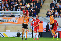 Mark Roberts loses out a header during the Sky Bet League 2 match between Cambridge United and Grimsby Town at the R Costings Abbey Stadium, Cambridge, England on 15 October 2016. Photo by PRiME Media Images.