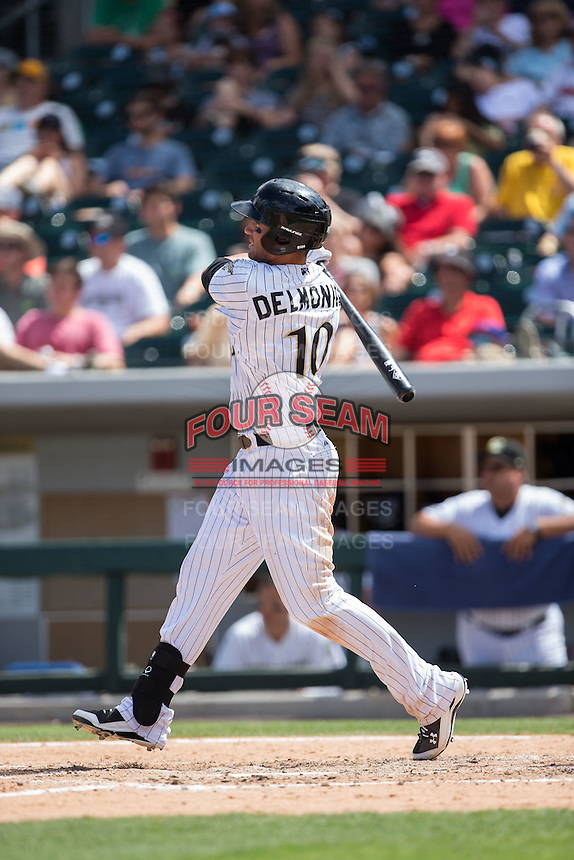 Nicky Delmonico (10) of the Charlotte Knights follows through on his swing against the Indianapolis Indians at BB&T BallPark on June 19, 2016 in Charlotte, North Carolina.  The Indians defeated the Knights 6-3.  (Brian Westerholt/Four Seam Images)