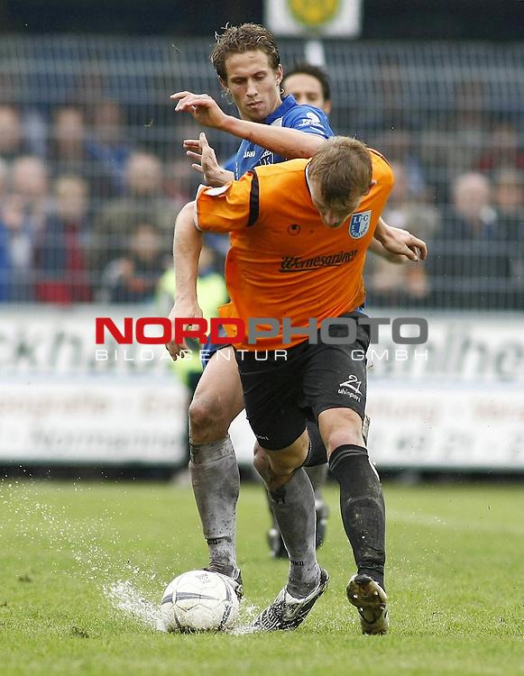 RLN 2007/2008 12. Spieltag Hinrunde<br /> BSV Kickers Emden -  1. FC Magdeburg<br /> Christopher Kullmann (Magdeburg#21) - Alexander Kr&uuml;ck (Emden#23)<br /> Foto &copy; nph (  nordphoto  )<br /> <br /> <br /> <br />  *** Local Caption ***