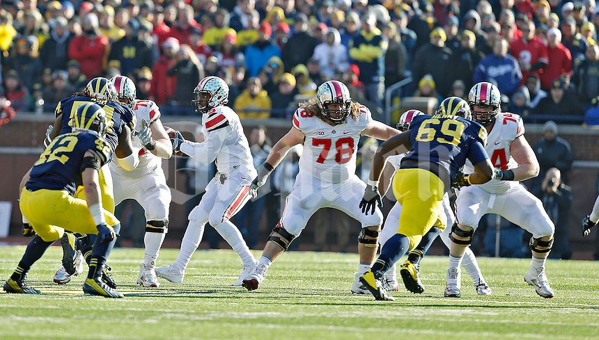Ohio State Buckeyes offensive linesman Corey Linsley (71), Ohio State Buckeyes offensive linesman Andrew Norwell (78) and Ohio State Buckeyes offensive linesman Jack Mewhort (74) against Michigan Wolverines during their college football game at Michigan Stadium in Ann Arbor, Michigan on November 30, 2013.  (Dispatch photo by Kyle Robertson)