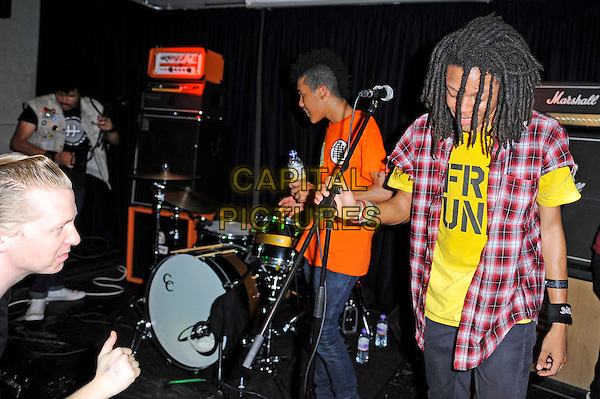 Solomon Radke &amp; Dee Radke of Radkey <br /> performing in concert, The Blackeart, Camden, London, England. <br /> 17th October 2013<br /> on stage in concert live gig performance performing music half length red check shirt yellow top      <br /> CAP/MAR<br /> &copy; Martin Harris/Capital Pictures