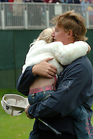 THOMASTOWN, IRELAND. Samantha Els hugh her Dad Ernie Els after we won the American Express Championship by one shot over Thomas Bjorn at the Mount Juliet Golf Club on October 3rd, 2004 in Thomastown, Ireland ..Photo AFP/NEWSFILE/FRAN CAFFREY..(Photo credit should read FRAN CAFFREY/NEWSFILE/AFP)...This Picture has been sent you under the condtions enclosed by:.Newsfile Ltd..the Studio,.Millmount Abbey,.Drogheda,.Co Meath..Ireland..Tel: +353(0)41-9871240.Fax: +353(0)41-9871260.GSM: +353(0)86-2500958.email: pictures@newsfile.ie.www.newsfile.ie.FTP: 193.120.102.198..This picture is from Fran Caffrey@newsfile.ie