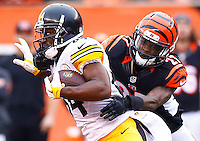 Antonio Brown #84 of the Pittsburgh Steelers runs after a catch in front of Dre Kirkpatrick #27 of the Cincinnati Bengals during the game at Paul Brown Stadium on December 12, 2015 in Cincinnati, Ohio. (Photo by Jared Wickerham/DKPittsburghSports)