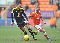 Oxford United's Jordan Graham under pressure from Blackpool's Jay Spearing<br /> <br /> Photographer Kevin Barnes/CameraSport<br /> <br /> The EFL Sky Bet League One - Blackpool v Oxford United - Saturday 23rd February 2019 - Bloomfield Road - Blackpool<br /> <br /> World Copyright © 2019 CameraSport. All rights reserved. 43 Linden Ave. Countesthorpe. Leicester. England. LE8 5PG - Tel: +44 (0) 116 277 4147 - admin@camerasport.com - www.camerasport.com