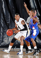 Florida International University guard DeJuan Wright (14) plays against Florida Memorial University in an exhibition game .  FIU won the game 86-69 on November 9, 2011 at Miami, Florida. .