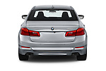 Straight rear view of a 2018 BMW 5 Series Sport 4 Door Sedan stock images