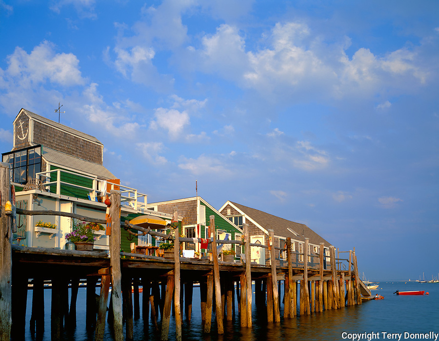 Cape Cod National Seashore, MA <br /> Evening clouds over Captain Jack's Wharf on Provincetown Harbor