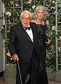 Former United States Secretary of State Henry A. Kissinger and Nancy Kissinger arrive for the State Dinner honoring Dinner honoring President Emmanuel Macron of the French Republic and Mrs. Brigitte Macron at the White House in Washington, DC on Tuesday, April 24, 2018.<br /> Credit: Ron Sachs / CNP