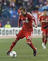 Toronto FC forward Jeremy Brockie (22) at midfield.  In a Major League Soccer (MLS) match, the New England Revolution (blue) defeated Toronto FC (red), 2-0, at Gillette Stadium on May 25, 2013.
