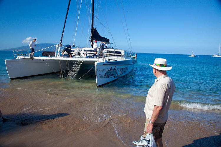 Passengers waiting to board a whale watching excursion from Kaanapali Beach aboard the Gemini, a large catamaran