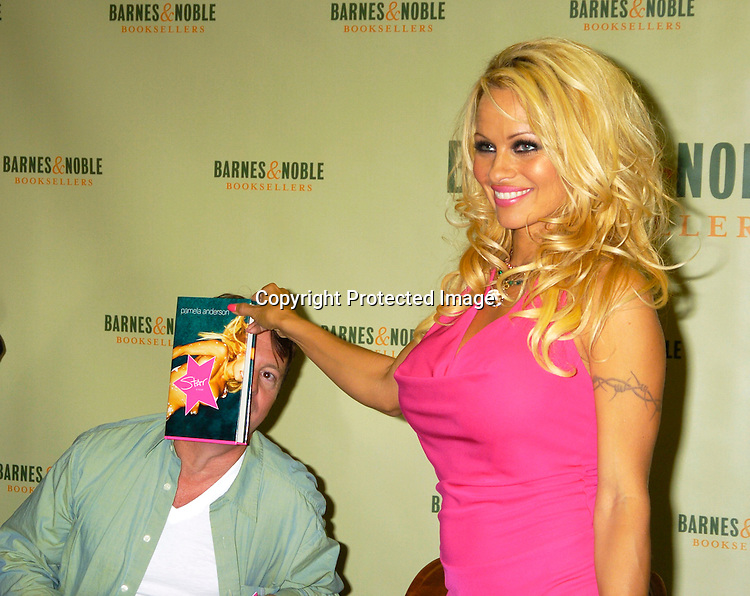 """Ghostwriter Eric Shaw and Pamela Anderson ..at a booksigning for Pamela Anderson's new novel  """"Star"""" ..on August 2,  2004 at Barnes and Nobles in New York City. ..Photo by Robin Platzer, Twin Images"""