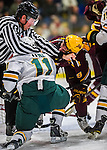 24 November 2012: NCAA Linesman Jeremy Lovett separates University of Vermont Catamount forward H.T. Lenz, a Junior from Vienna, VA, from forward Erik Haula, a Junior from Pori, Finland, during play between the University of Vermont Catamounts and the University of Minnesota Golden Gophers at Gutterson Fieldhouse in Burlington, Vermont. The Catamounts fell to the Gophers 3-1 in the second game of their 2-game non-divisional weekend series. Mandatory Credit: Ed Wolfstein Photo