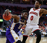 SIOUX FALLS, SD: MARCH 4: Garret Covington #31 of Western Illinois drives on Trey Dickerson #0 of South Dakota on March 4, 2017 during the Summit League Basketball Championship at the Denny Sanford Premier Center in Sioux Falls, SD. (Photo by Dick Carlson/Inertia)