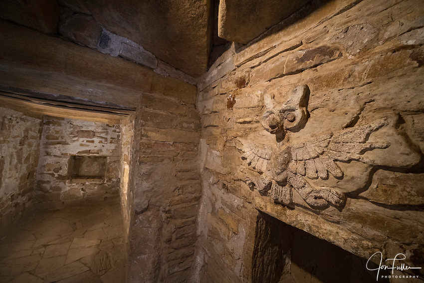 Stucco frieze figures depicting an owl and representations of Lord Nine Flower inside Tomb 1, his crypt, at the ruins of the Zapotec city of Zaachila in the Central Valley of Oaxaca, Mexico.