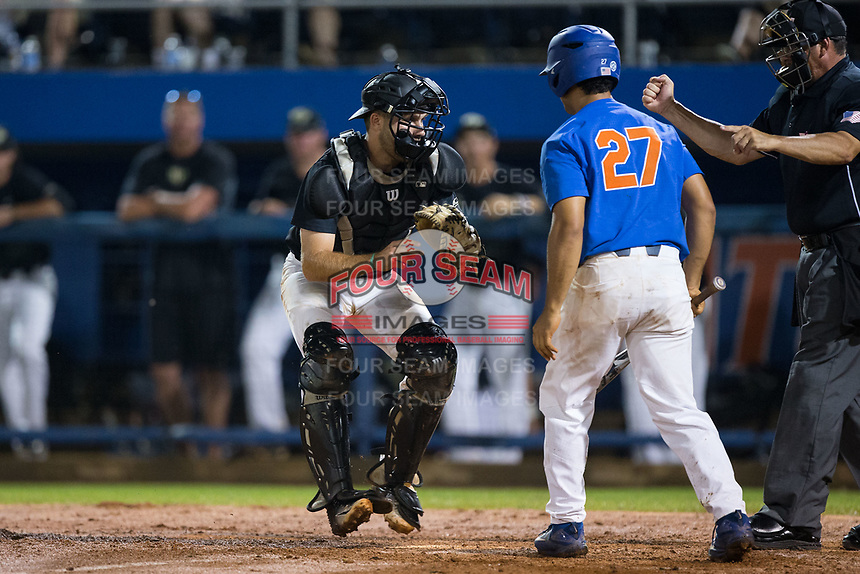 Wake Forest Demon Deacons catcher Logan Harvey (15) tags out Nelson Maldonado (27) of the Florida Gators after a dropped third strike in Game Three of the Gainesville Super Regional of the 2017 College World Series at Alfred McKethan Stadium at Perry Field on June 12, 2017 in Gainesville, Florida.  The Gators defeated the Demon Deacons 3-0 to advance to the College World Series in Omaha, Nebraska.   (Brian Westerholt/Four Seam Images)