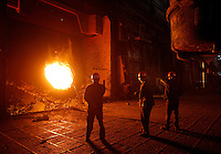 Workers stand next to a steel smelter at Ma Steel (Maanshan Iron & Steel Co.) in Maanshan, Anhui Province, China..
