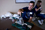 Brandon Lenese explains his prototype of an electromagnetic piston engine powered by liquid fuel rather than electricty.