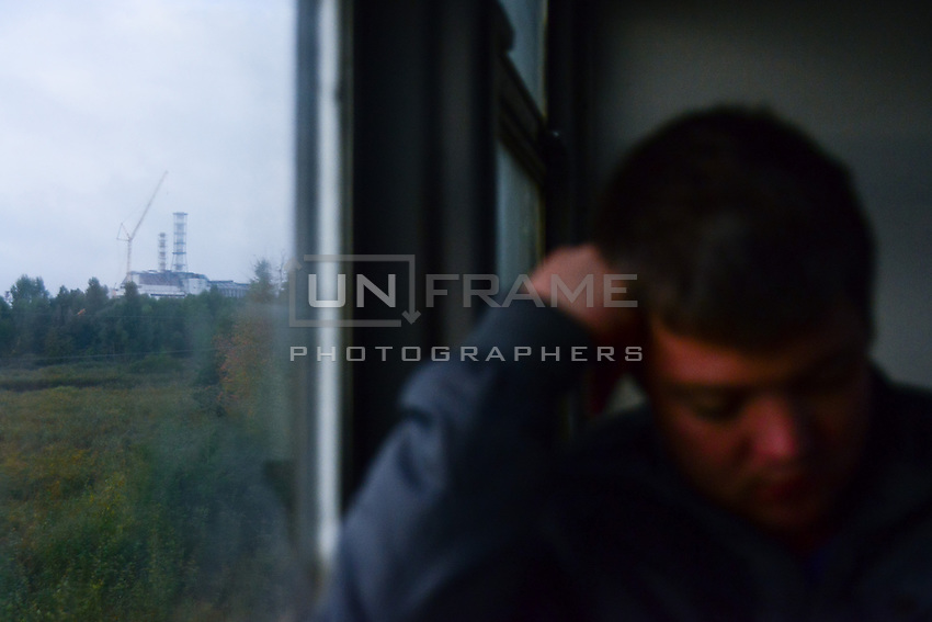 A worker of the Chernobyl Nuclear Power Plant on his way to work. There are 15 days shifts after which employees come back to their families - some are hundred kilometers away in another part of the country.