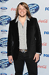 Caleb Johnson arriving at the 'American Idol XIII Finalists Party' held at Fig and Olive in Los Angeles on February 20, 2014