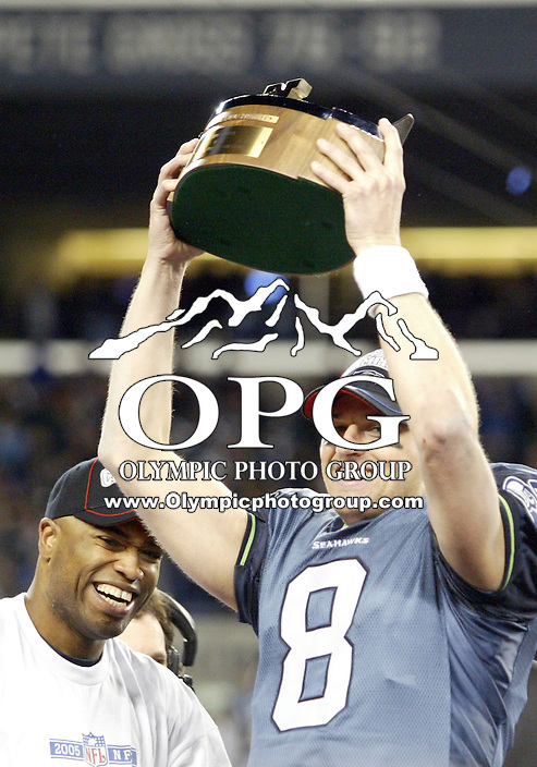 January 22, 2005:  Seattle Seahawks quarterback Matt Hasselbeck holds up the NFC championship trophy to the fans at Quest Field after helping defeat the Carolina Panthers  in Seattle, WA.