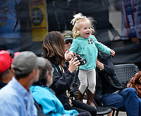 NWA Democrat-Gazette/BEN GOFF -- 04/23/15 Reese Arey, 2, cheers as her dad Matt Arey of Shelby, N.C. weighs-in after day 1 of the Walmart FLW Tour at Beaver Lake in Rogers on Thursday Apr. 23, 2015.