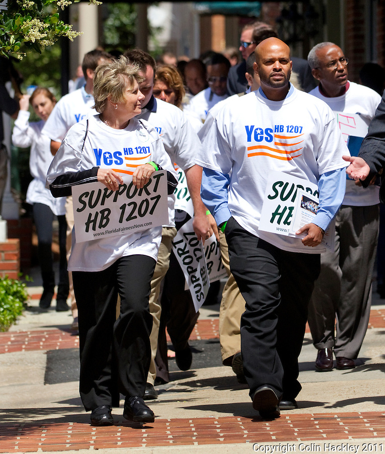 TALLAHASSEE, FLA. 4/5/11-CFFF040511 CH-Members of Citizens For Fairness In Florida march to the Capitol to show their support for House Bill 1207 Tuesday in Tallahassee. The bill closes a loophole in Florida's tobacco payment system..COLIN HACKLEY PHOTO
