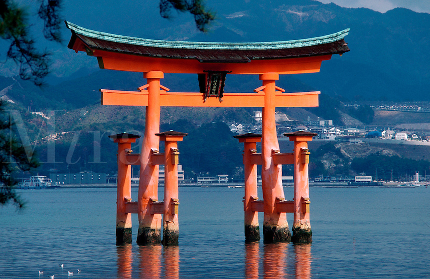 A grand Torii gateway, a traditional Shinto structure on the grounds of the Itsukushima shrine. Miyajima, Japan.