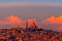 Sacre Coeur Basilica sits atop Montmatre, a large hill (butte) in northern Paris, France.