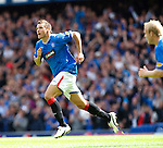 Lee McCulloch races off to celebrate his goal.