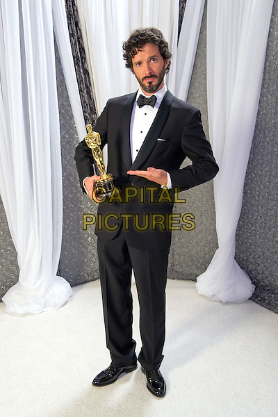 "Bret McKenzie, Oscar® winner for Achievement in Music Written for Motion Pictures (Original Song) for ""Man or Muppet"" from ""The Muppets"", Music and Lyrics by Bret McKenzie, poses backstage during the live ABC Television Network broadcast of the 84th Annual Academy Awards® from the Hollywood and Highland Center, in Hollywood, CA, Sunday, February 26, 2012..*Editorial Use Only*.oscars award trophy winner full length black tuxedo  .CAP/A.M.P.A.S./NFS.©A.M.P.A.S. Supplied by Capital Pictures."
