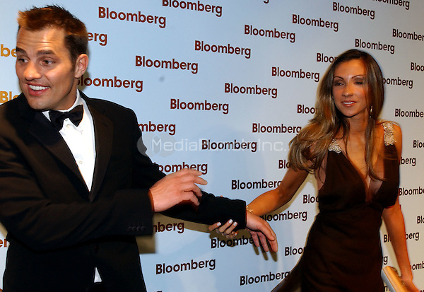 "Washington, DC - May 1, 2004 -- Katrina Campins, right, seems to be pulling Bill Rancic, left,  into the Bloomberg party following the 2004 White House Correspondents Association Dinner in Washington, D.C. on May 1, 2004.  Both starred in the NBC reality series ""The Apprentice"" with Donald Trump..Credit: Ron Sachs/ CNP/MediaPunch.(RESTRICTION: No New York Metro or other Newspapers within a 75 mile radius of New York City)"