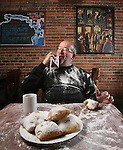 Artist Phil Bender with some beignets at Lucile's Creole Cafe in Denver, Colorado.