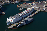aerial photograph of the US Navy Hospital Ship Mercy, docked adjacent to a Zumwalt class destroyer, San Diego, California
