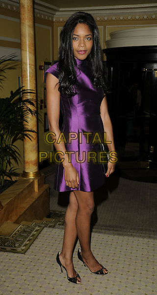 NAOMIE HARRIS.The Ndoro Children's Charities fundraising gala at The Dorchester Hotel, London, England. .September 17th, 2009 .full length purple silk Victoria Beckham designed dress collar high neck open peep toe shoes black clutch bag .CAP/CAN.©Can Nguyen/Capital Pictures.