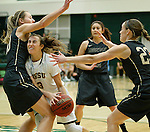 SPEARFISH, SD - FEBRUARY 4, 2017 -- Julia Seamans #3 of Black Hills State drives between UCCS defenders during their Rocky Mountain Athletic Conference game Saturday at the Donald E. Young Center in Spearfish, S.D.  (Photo by Dick Carlson/Inertia)